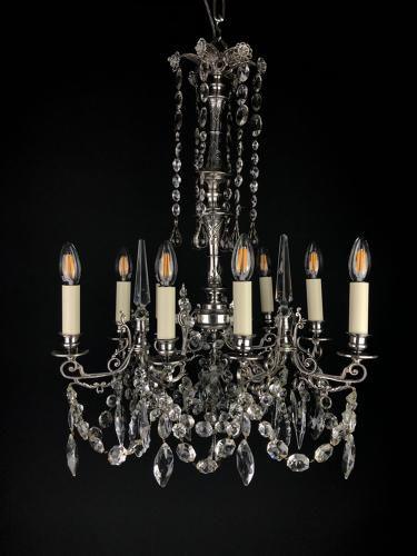 A silvered Gothic nine light chandelier