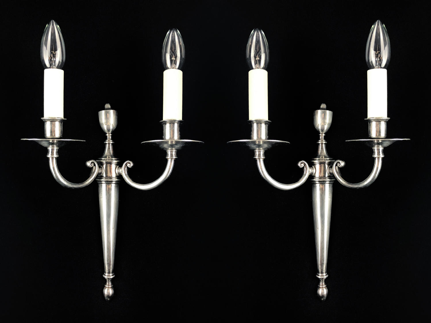 A set of four silvered two arm wall lights