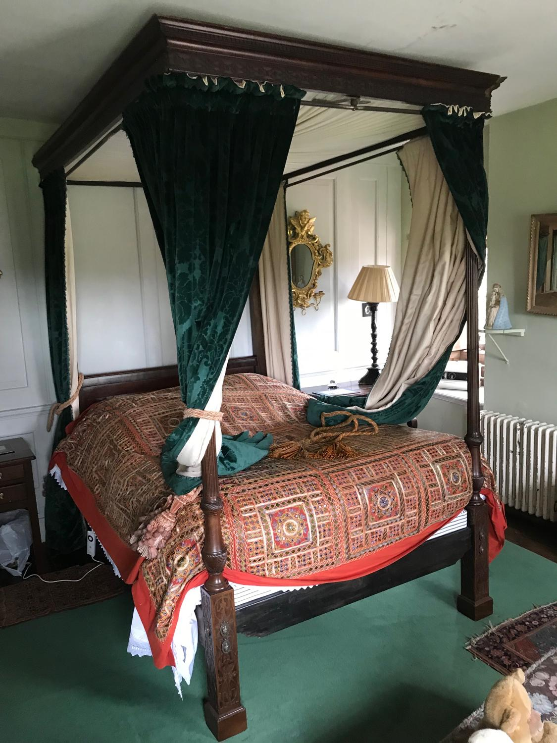 A George III, Chippendale style four poster bed