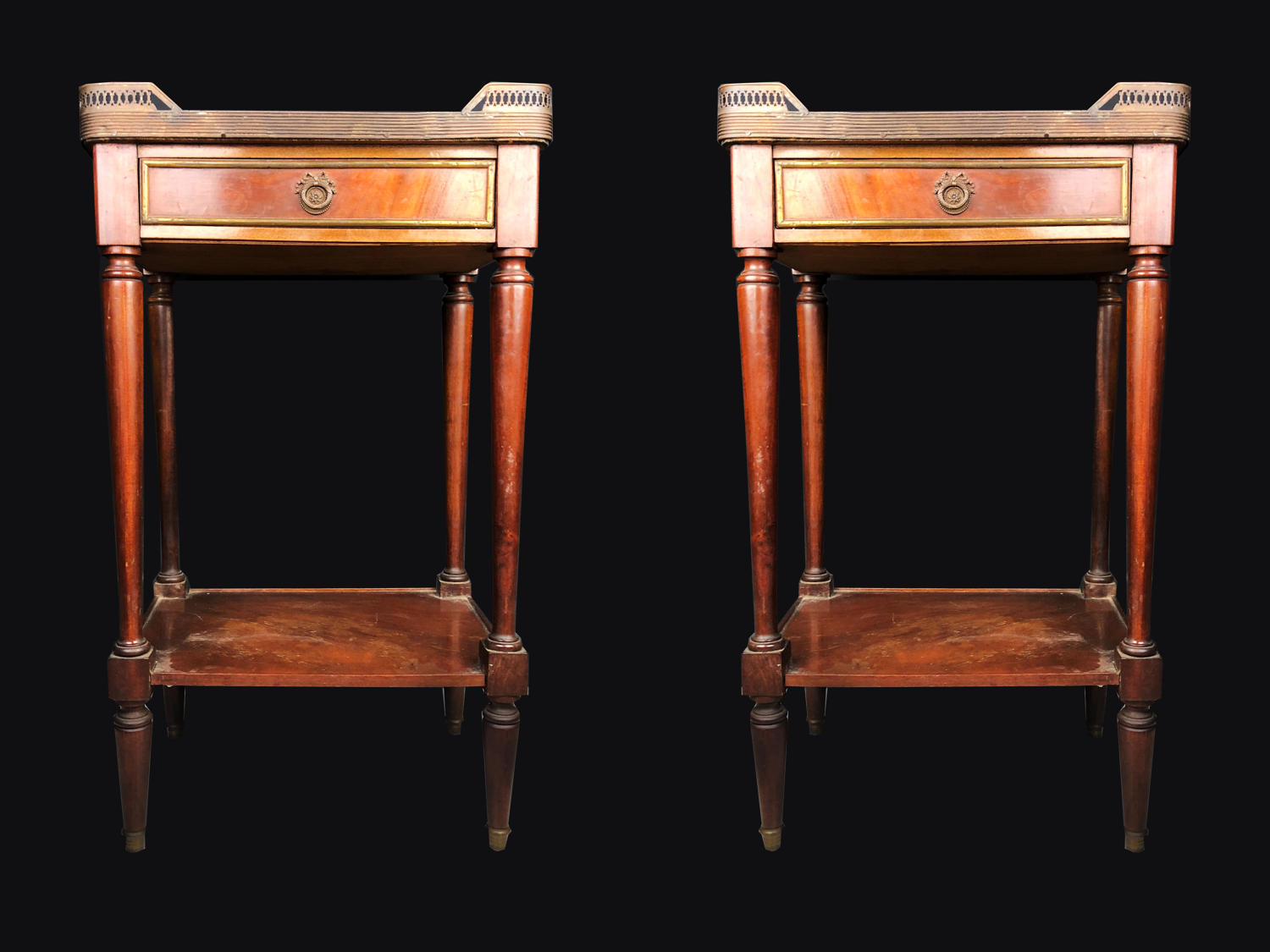 A pair of mahogany marble topped bedside cabinets