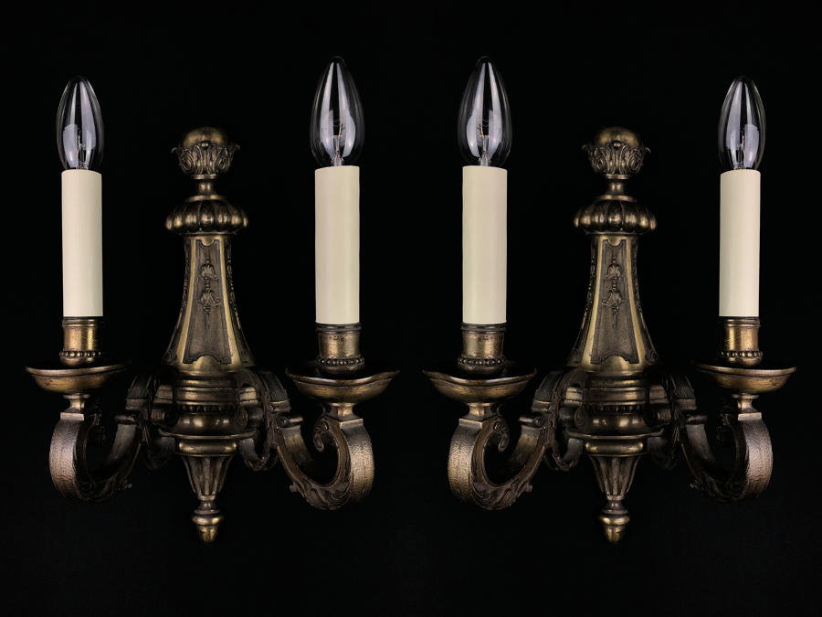 A set of four large Regency style wall lights