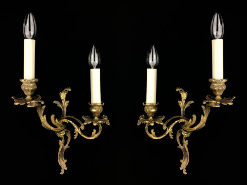 A pair of Rococo style wall lights