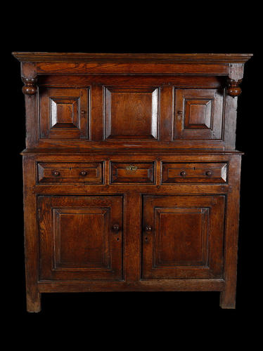 An oak court cupboard