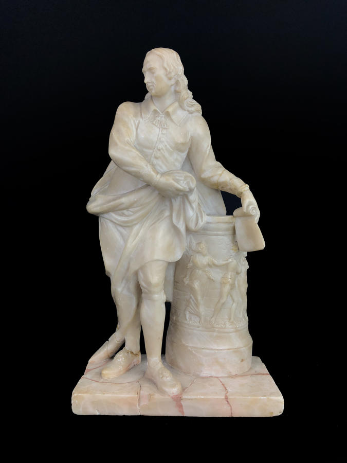 A carved alabaster figure of John Milton
