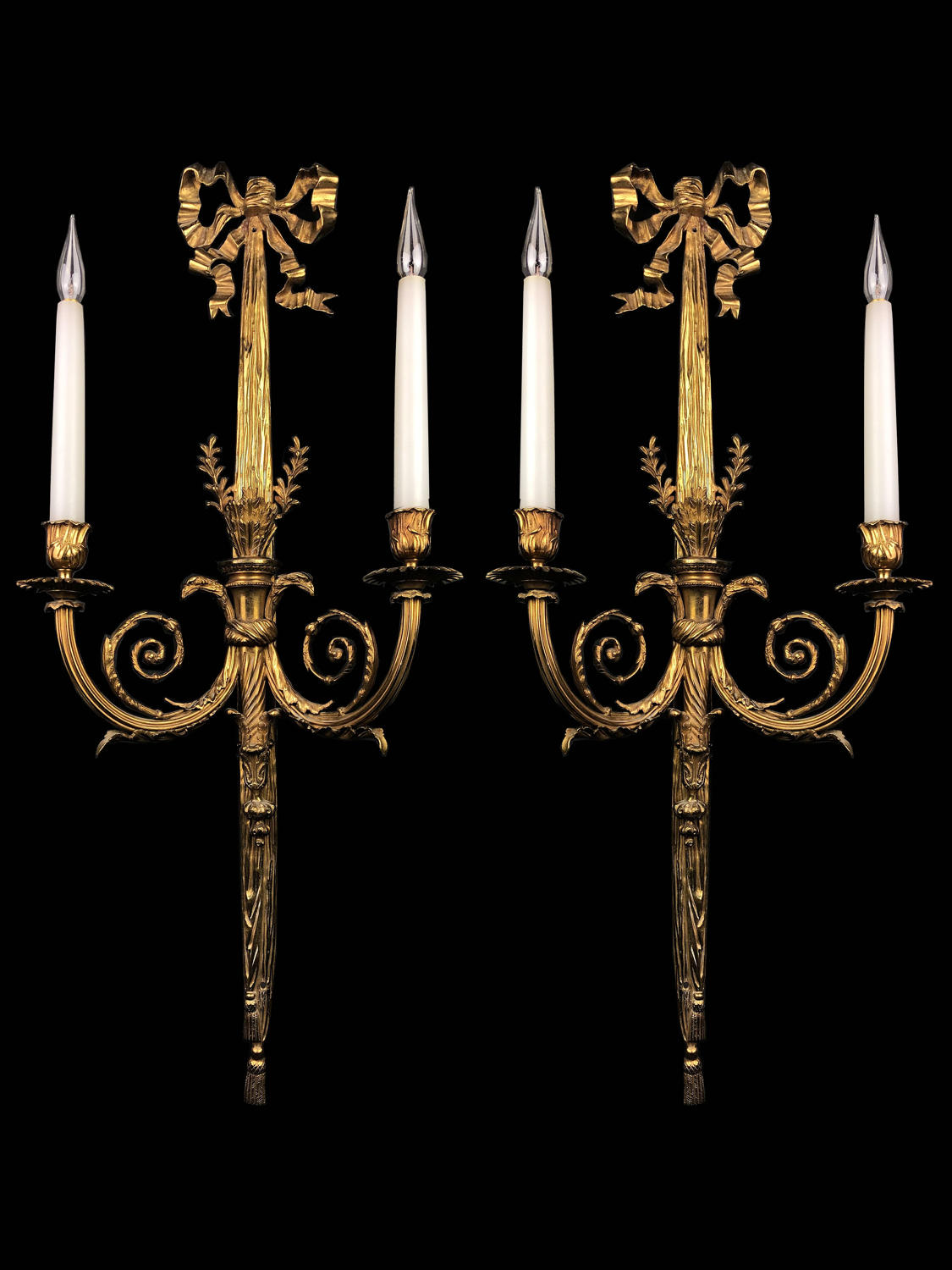 A large pair of Louis XVI style wall appliques