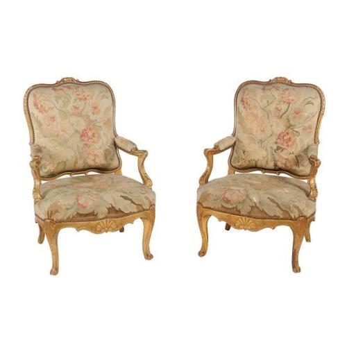 A pair of gilt-wood and tapestry chairs