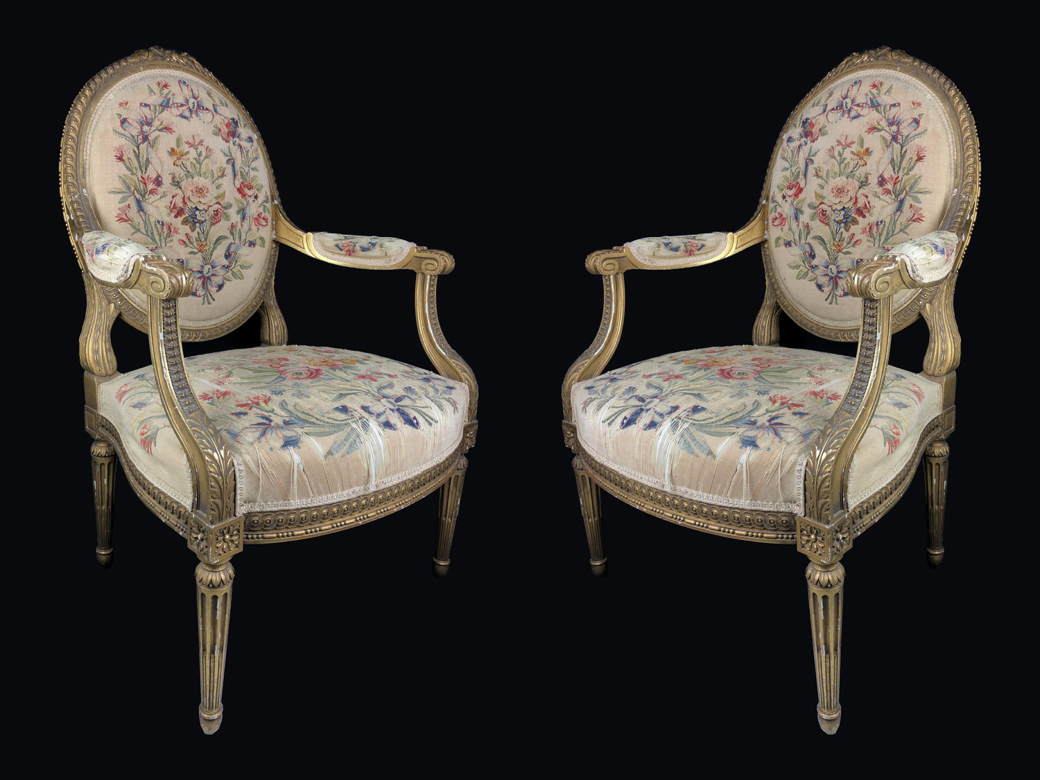 A set of four gilt-wood arm chairs
