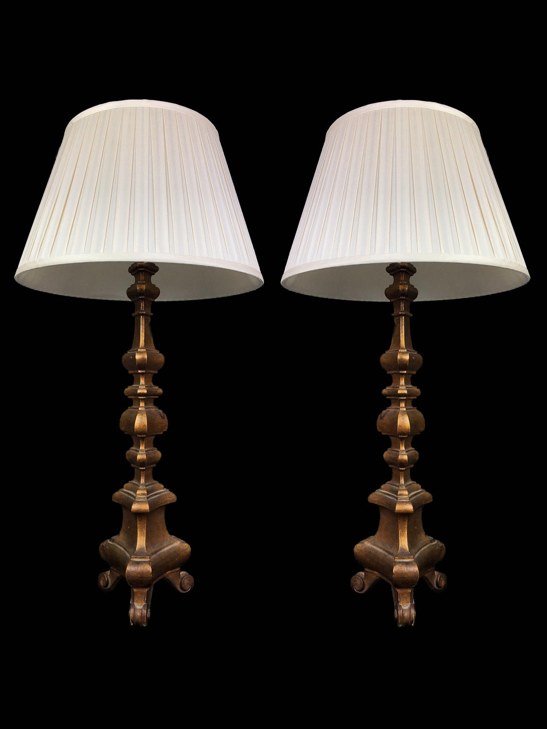A pair of gilt-wood alter candlestick lamps