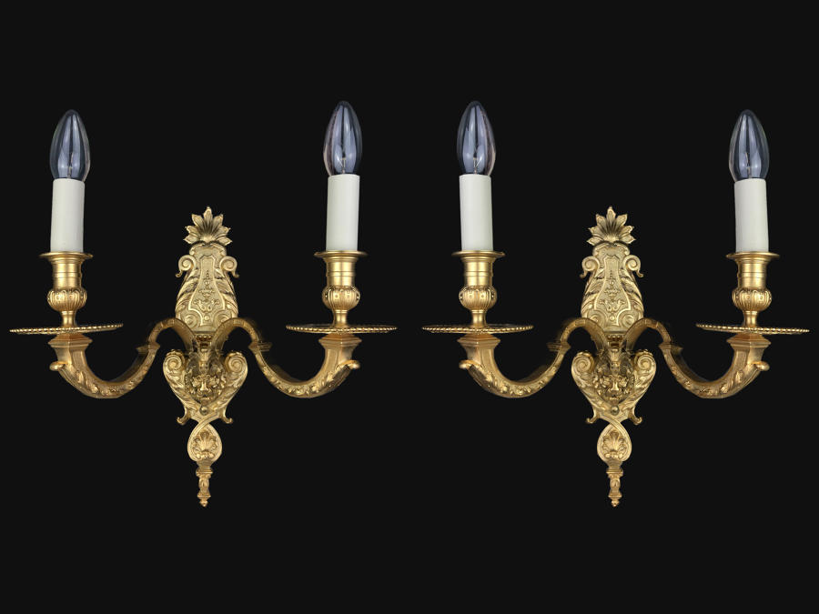 A pair of gilt-bronze Louis XVI style wall lights