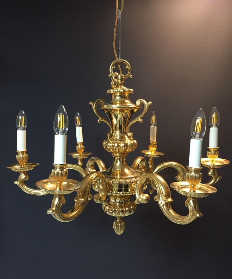 A six arm, Charles II style gilt-bronze chandelier