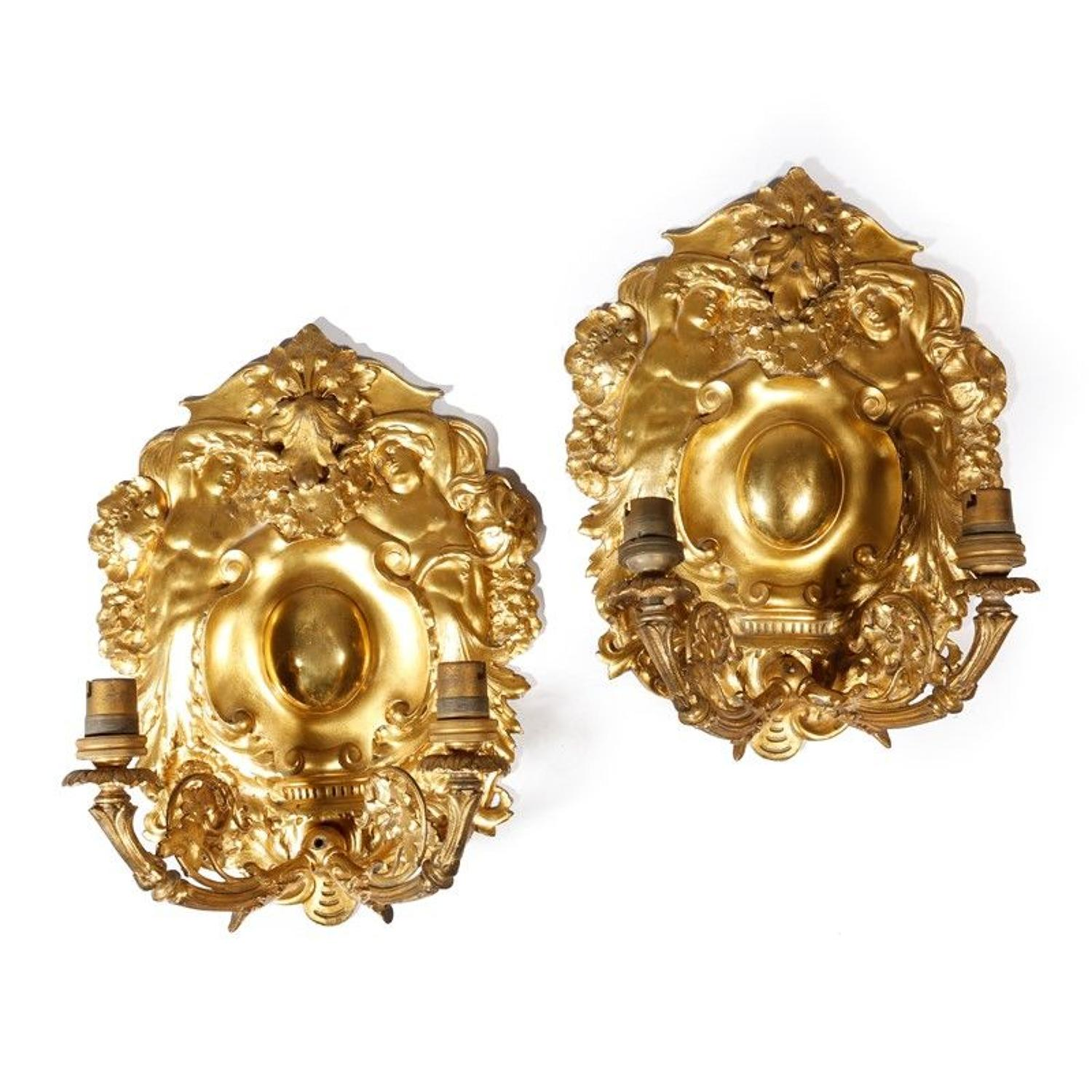 A pair of Ormolu shield wall lights