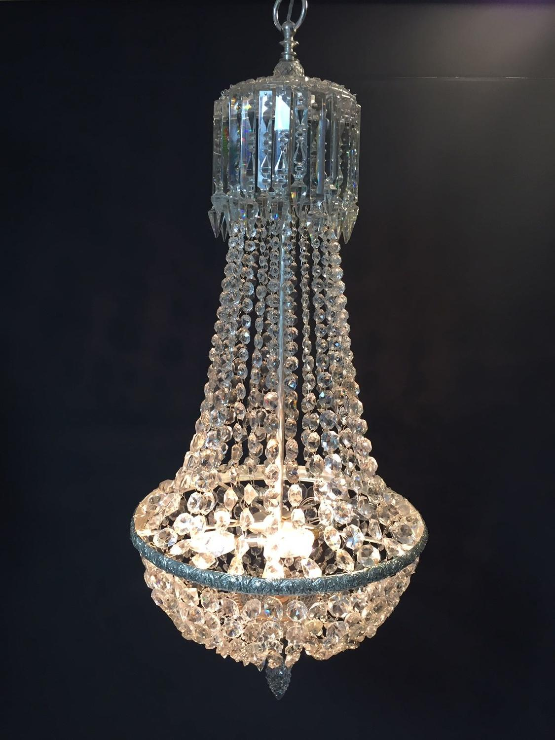 A silvered tent and waterfall chandelier
