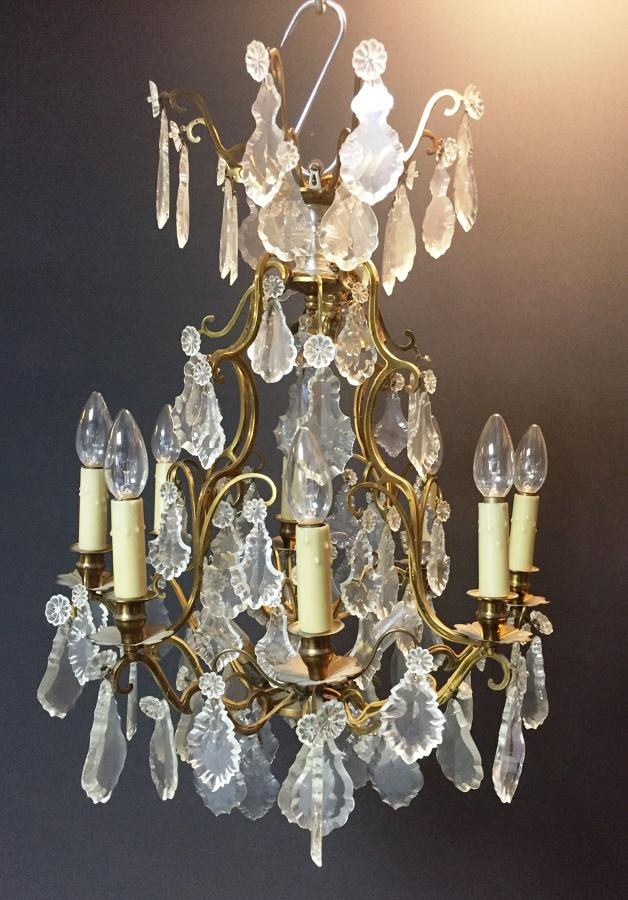 An eight arm gilt-brass and cut glass chandelier