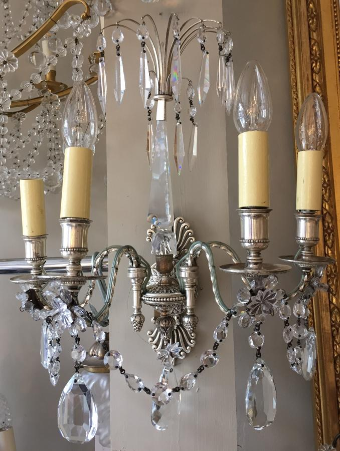 A pair of silvered Louis XVI style wall lights