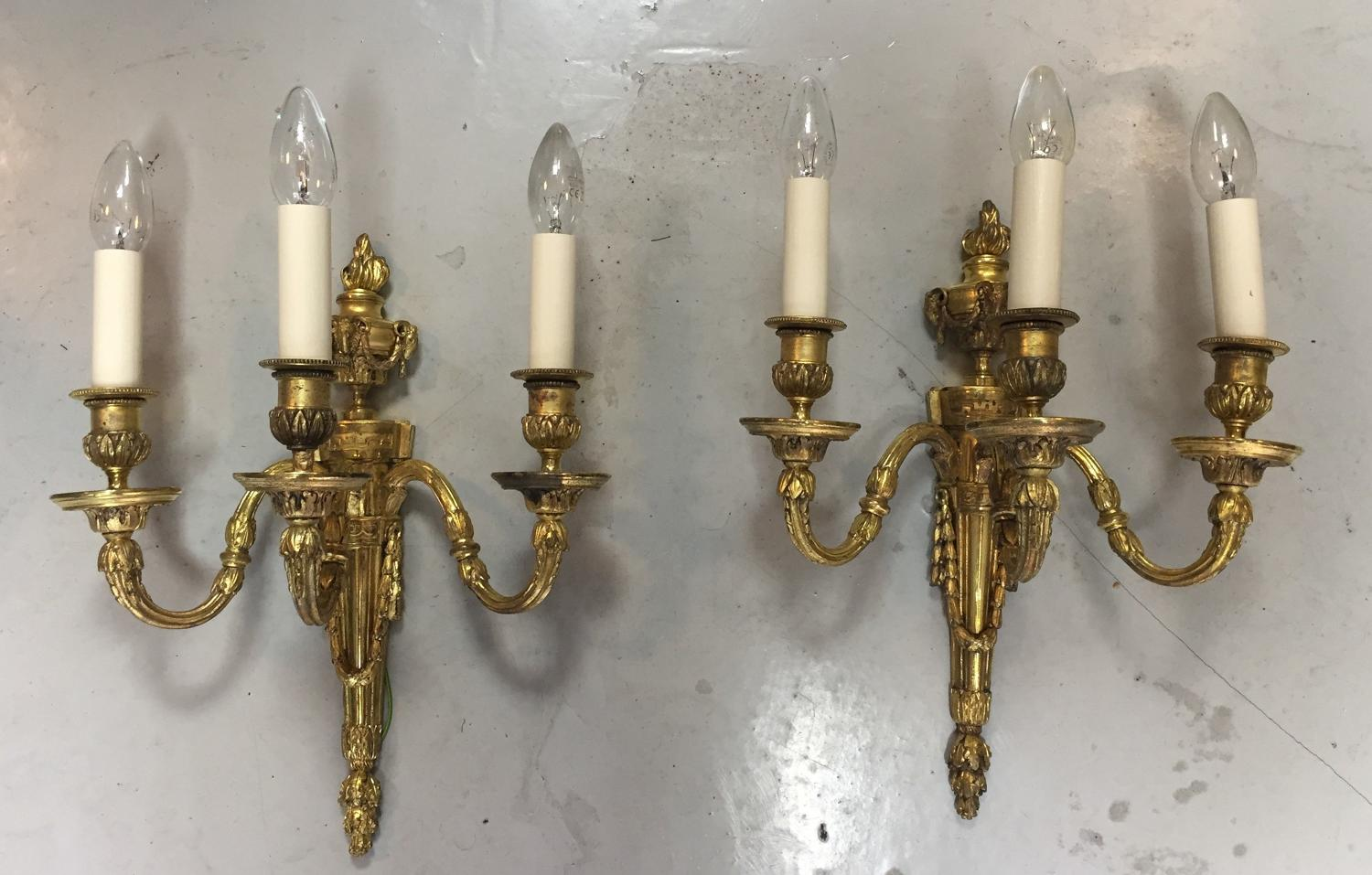 A set of three large Adam style wall lights