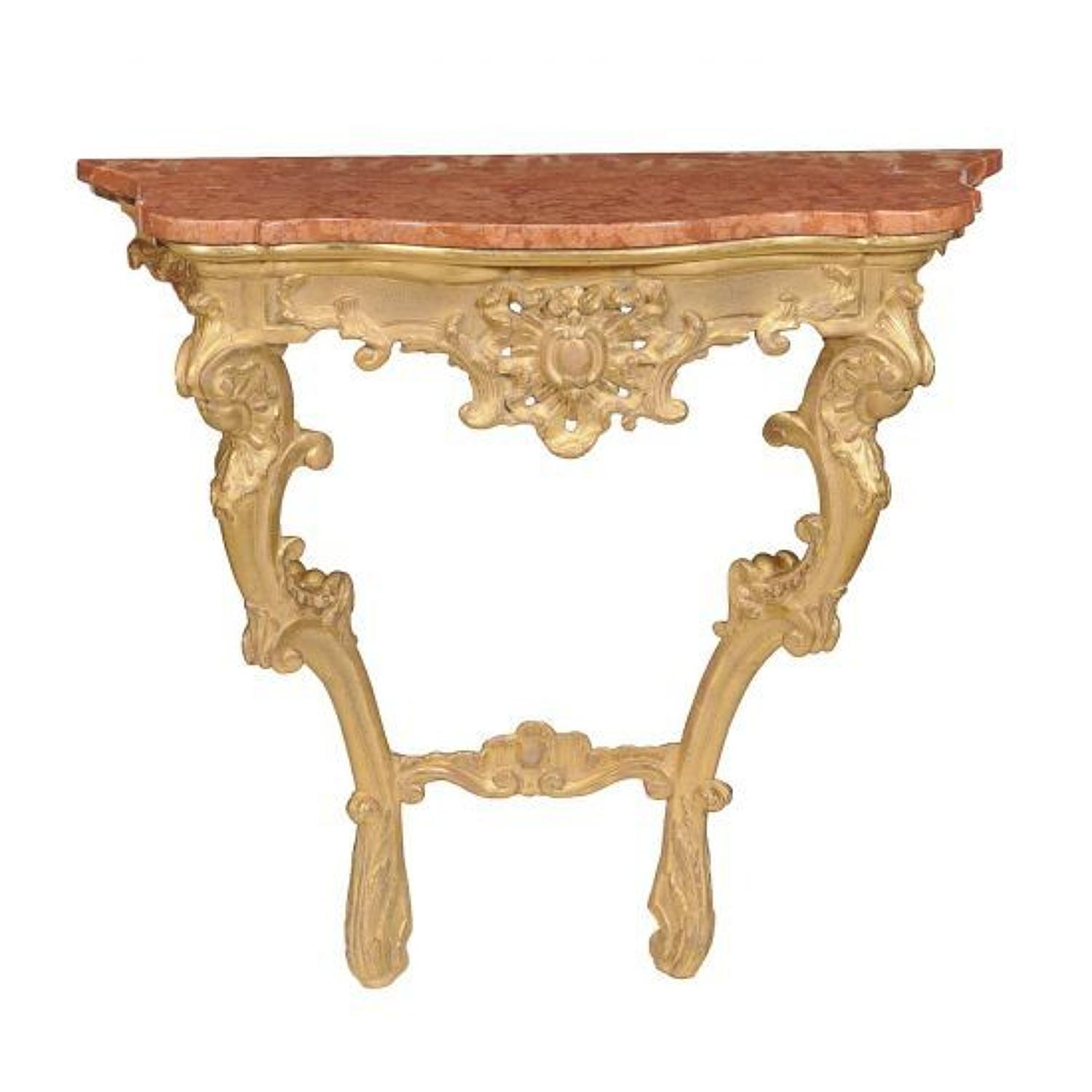 A gilt-wood and marble topped console table