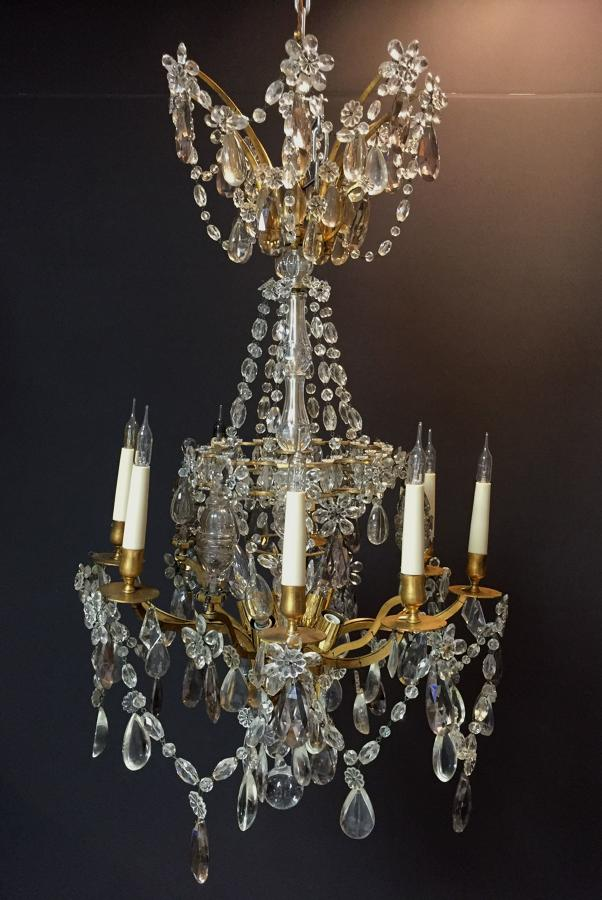 A gilt-bronze and crystal chandelier in the manner of Bagues