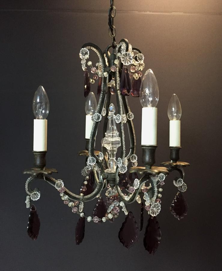 A charming black metal and amethyst chandelier