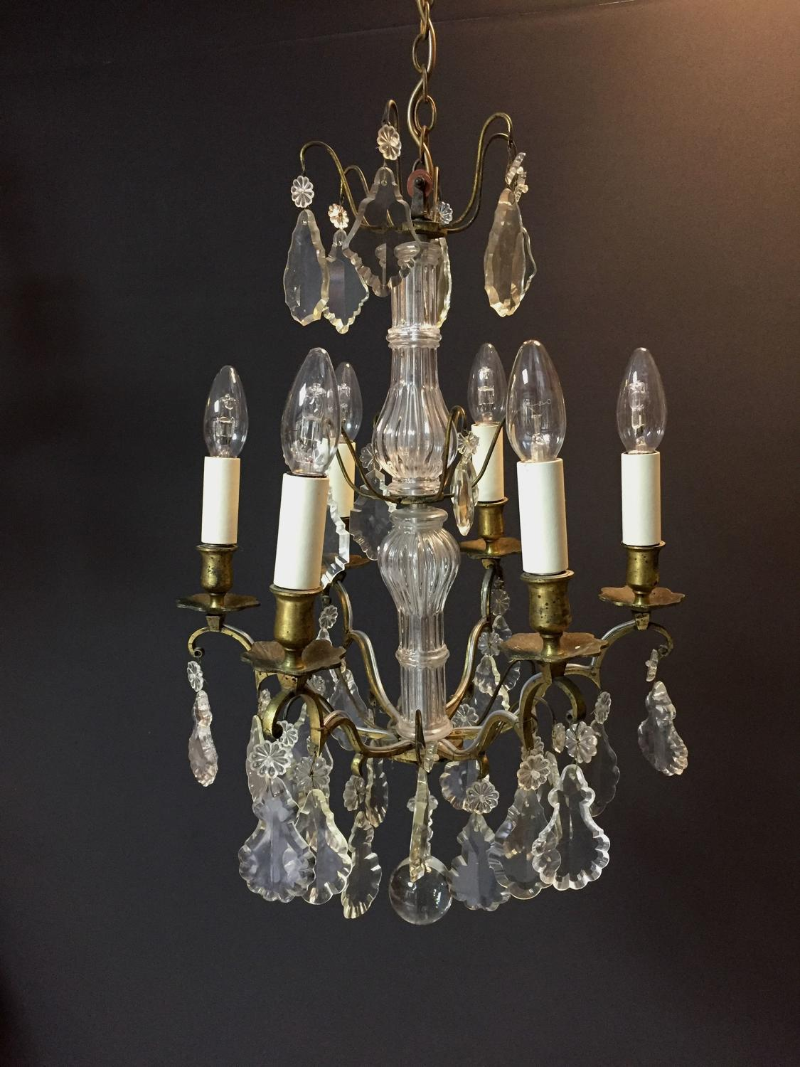 A gilt-brass and cut glass six arm chandelier