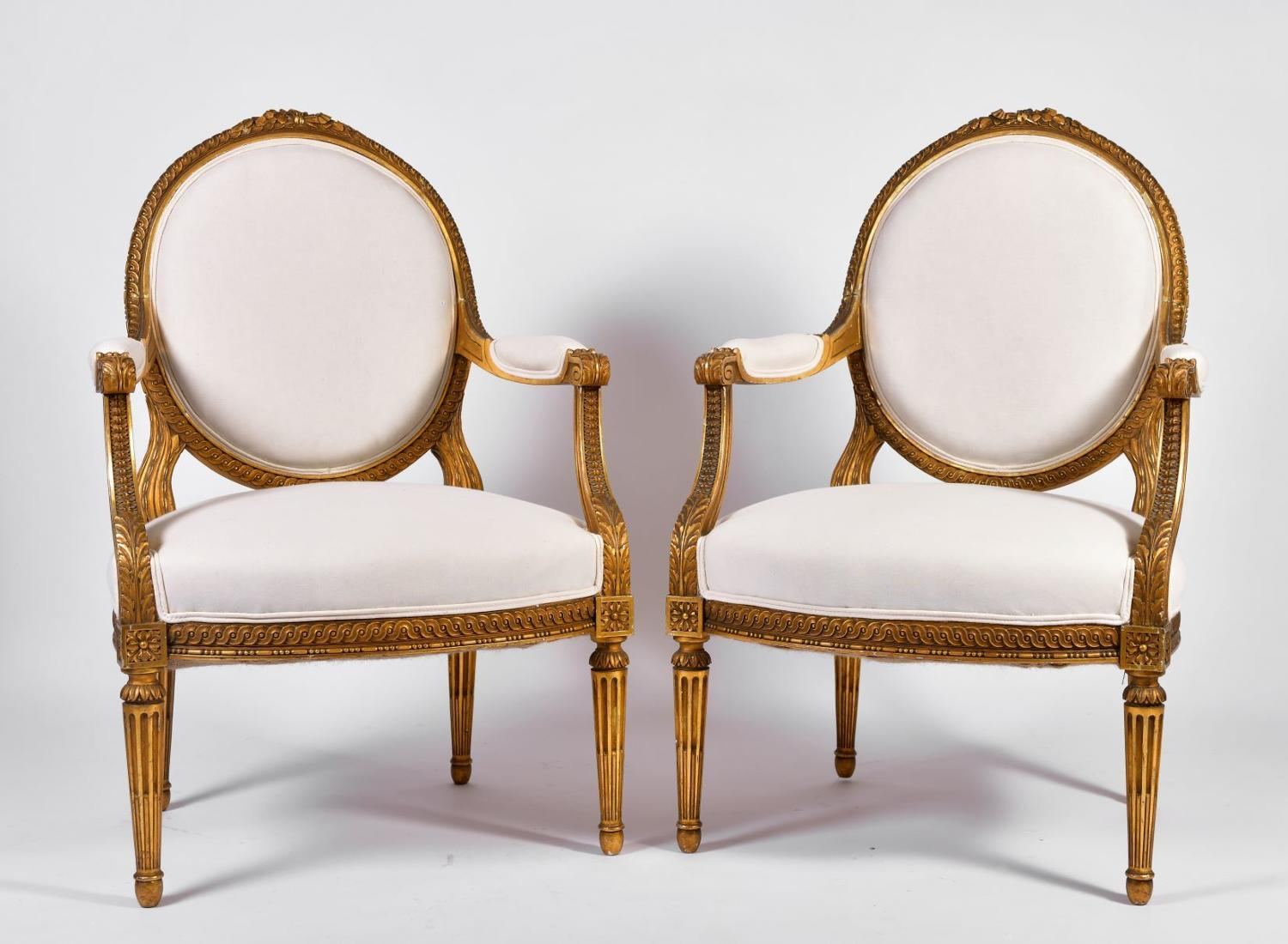 A set of four oval back Louis XVI style armchairs