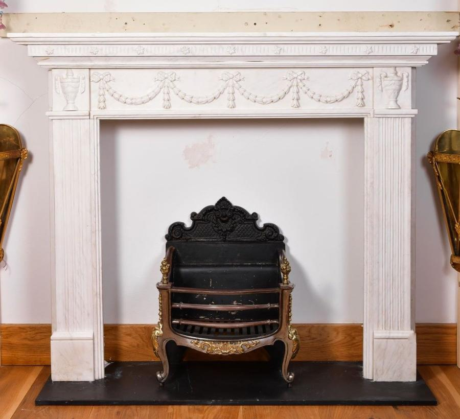 An Adam style white marble fireplace