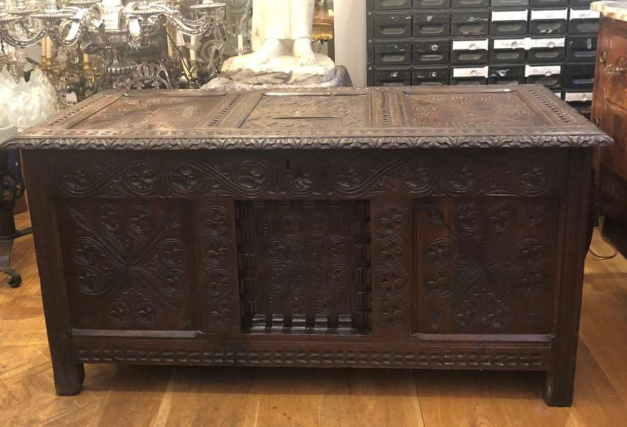 An oak panelled carved coffer