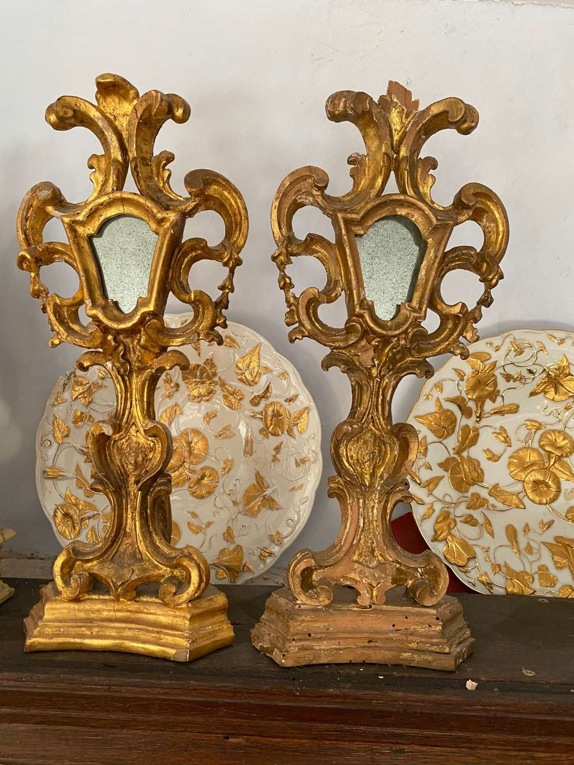 A pair of carved, gilded reliquaries