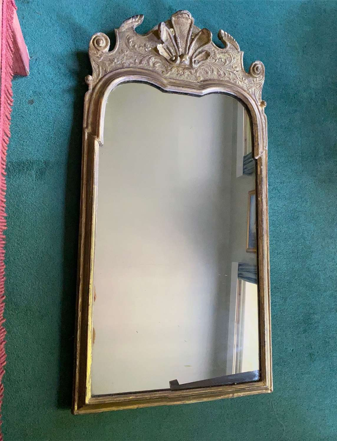 A Queen Anne cavedwood gilt and gesso Mirror