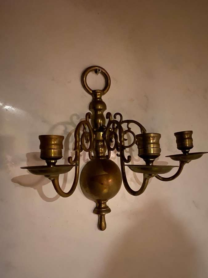A pair of three branch Dutch style wall lights