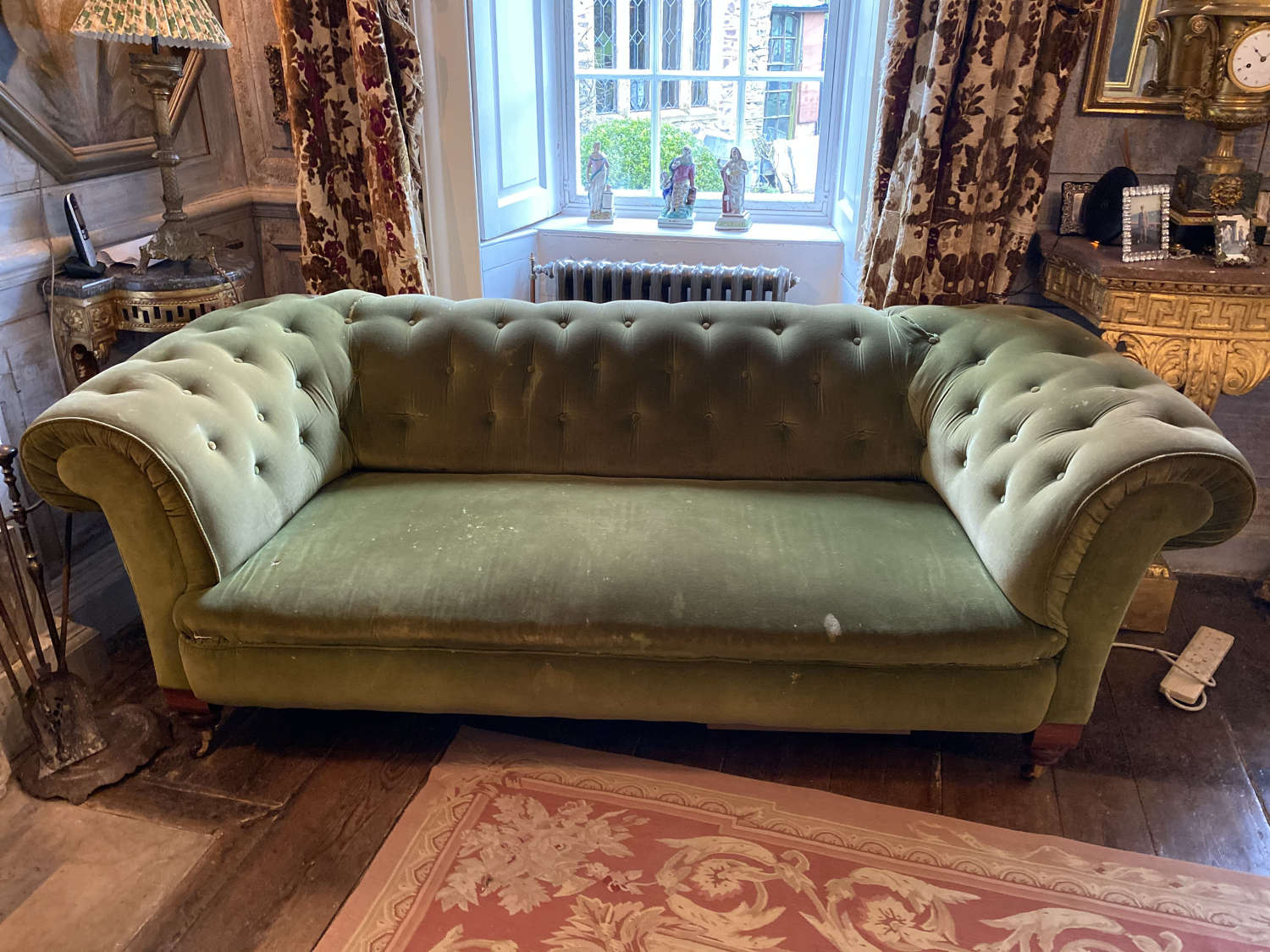A 19 sentry velvet button back settee