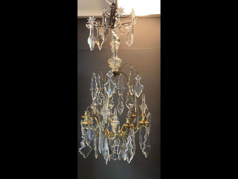 A Louis sixteenths style cut crystal glass chandelier