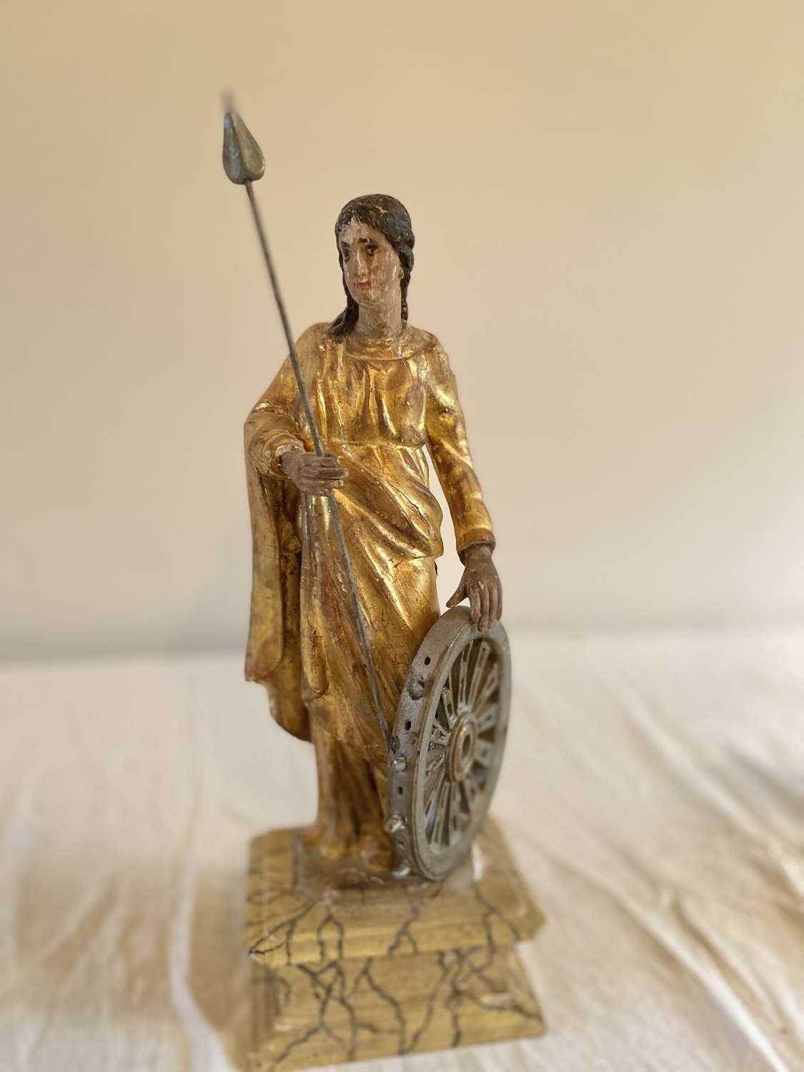A carved wood effigy of Saint Catherine