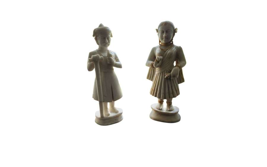 A pair of Carrara white translucent marble 19th-century Indian figures