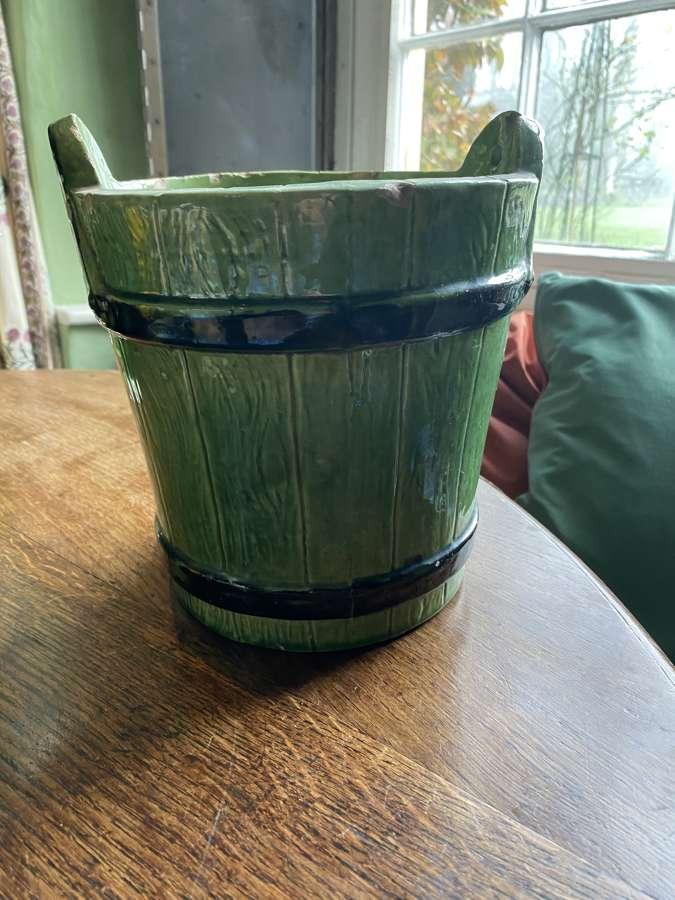 A pale green ceramic pale