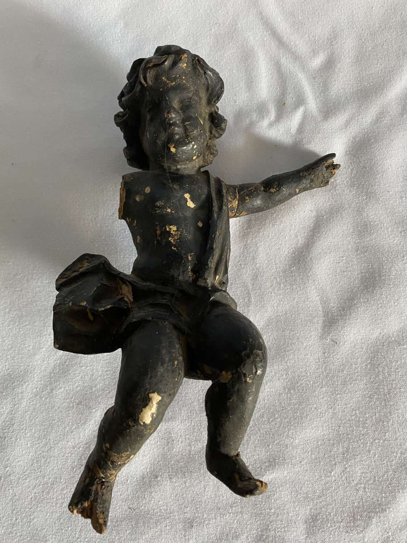 An Italian carved wood cherub