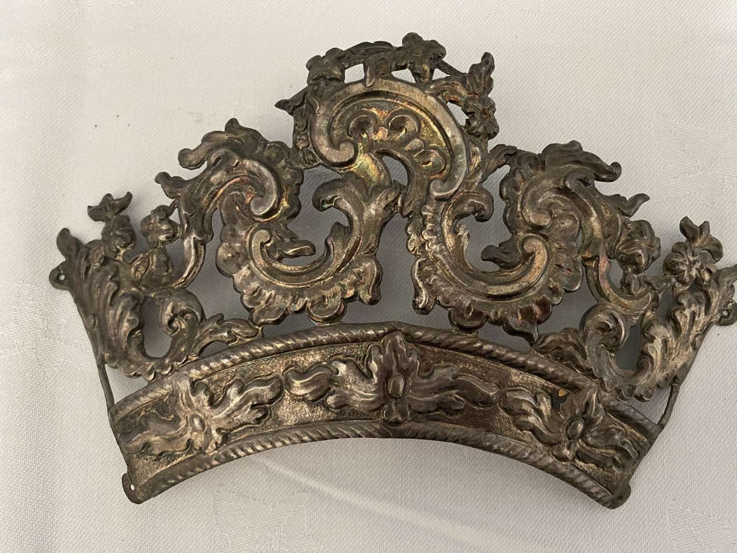 A continental white metal pressed crown