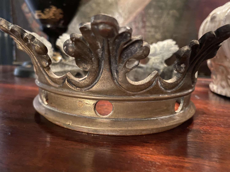 A cast brass or bronze crown