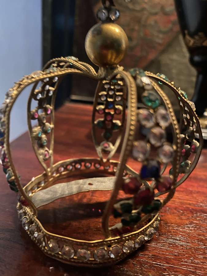 A small brass tiara sets with old cut glass diamonds