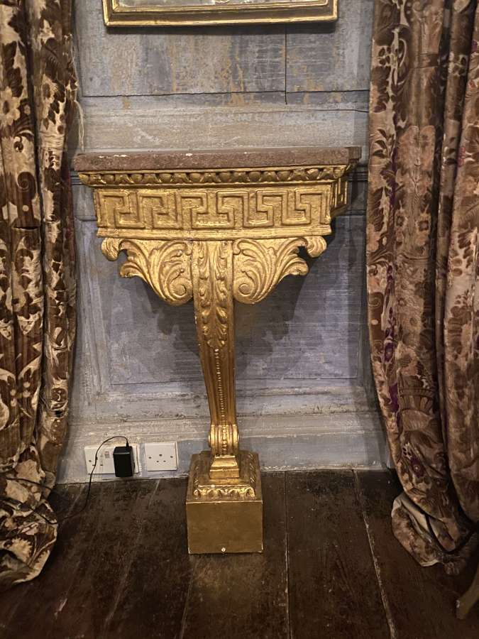 A gilt-wood and Palfray topped console table