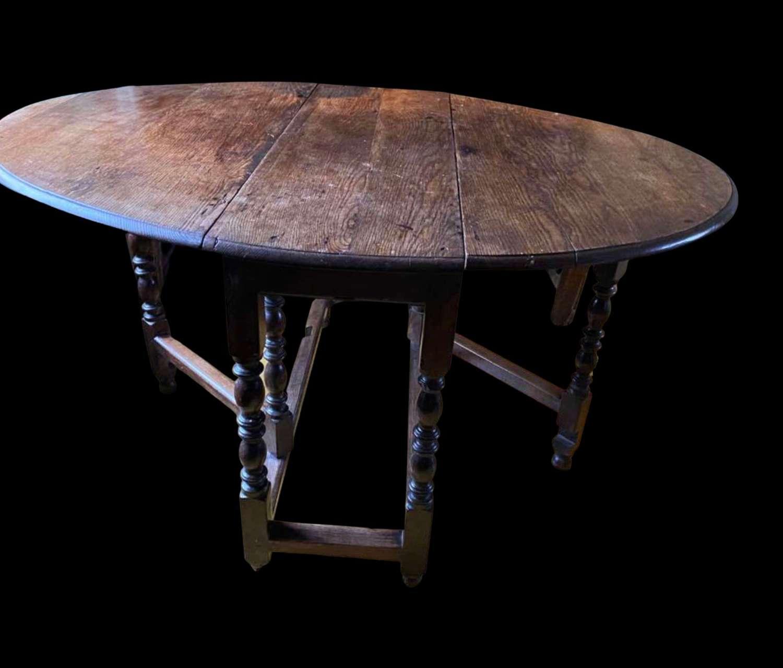 17th century oak dropleaf gateleg table with single draw
