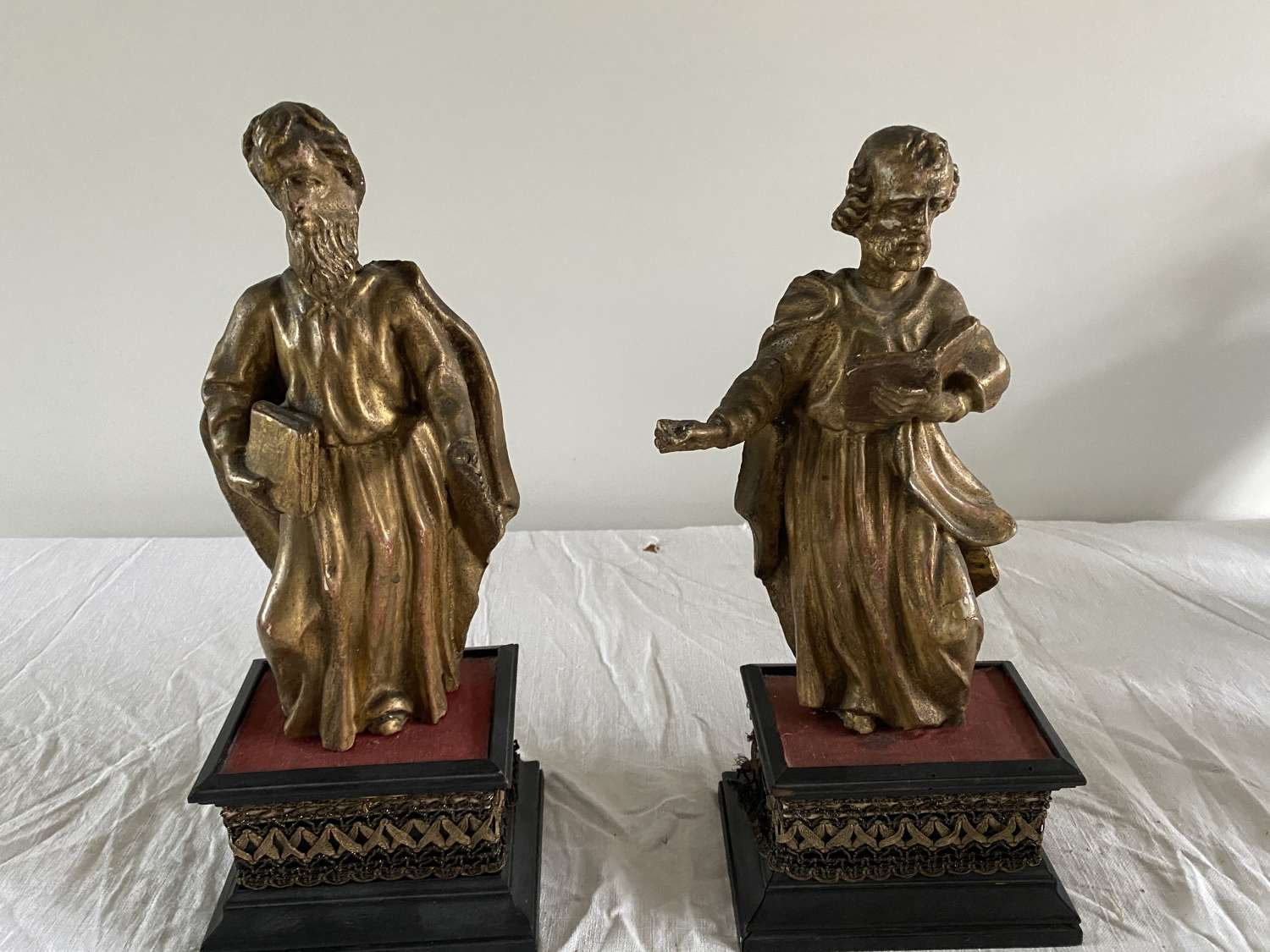 A pair of Carved limewood and gilded figures