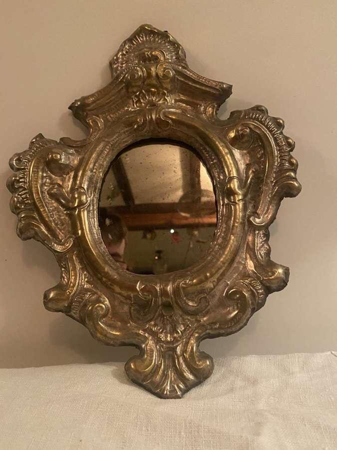 An Italian repose pressed white metal small Italian mirror