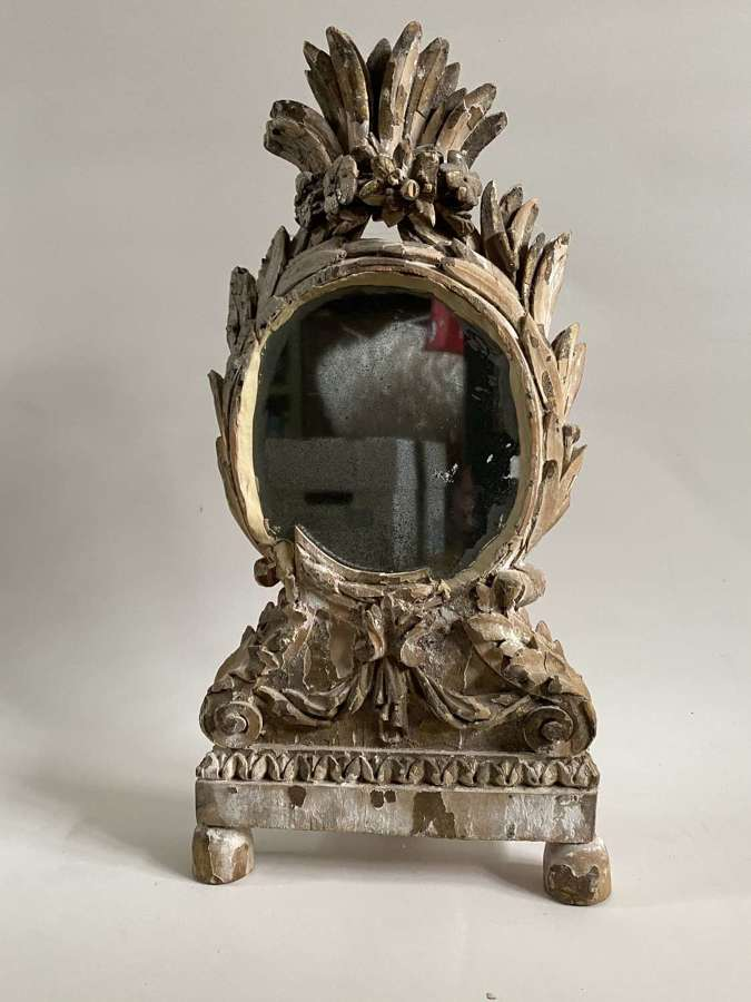 A carved Beechwood French mirror