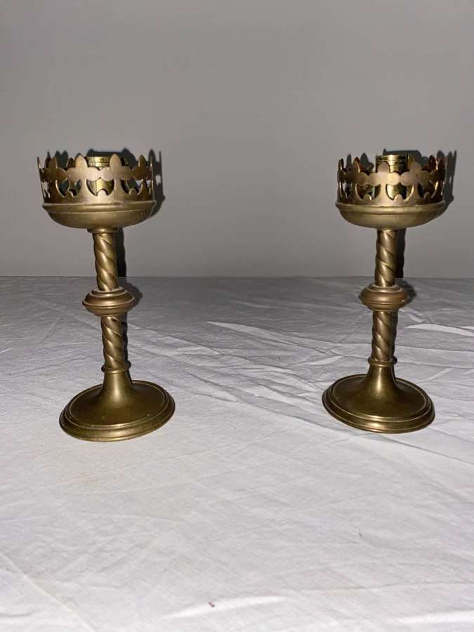 A pair of English solid brass Gothic style 19 century candlesticks