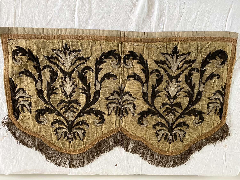 Gold and silver thread on dark velvet