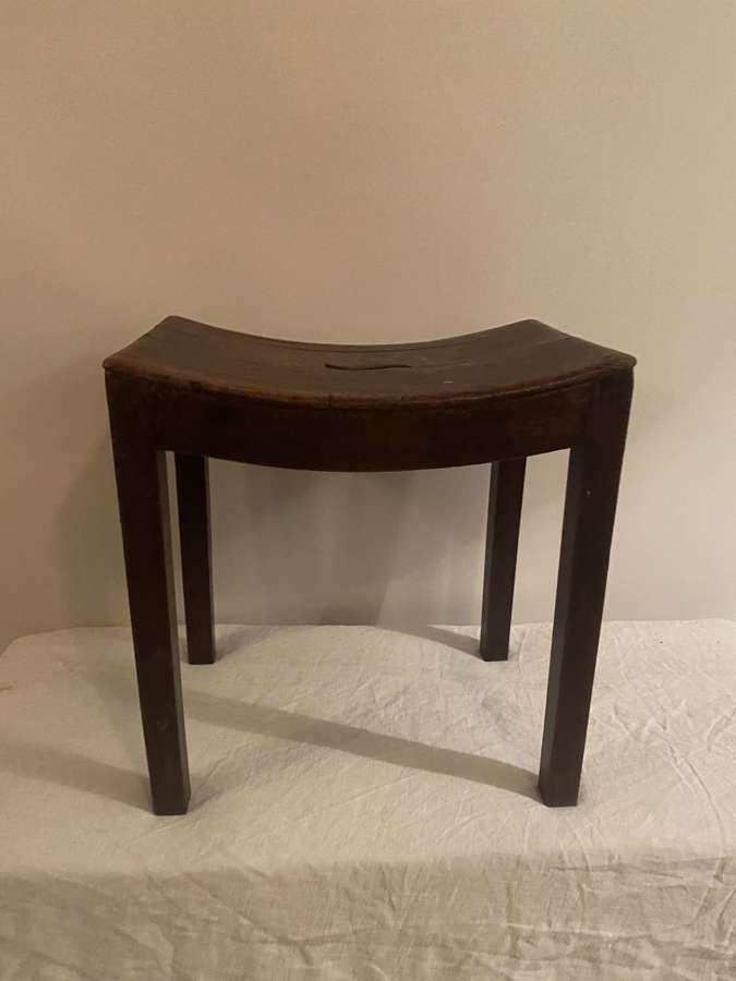 Mahogany saddle shaped stool