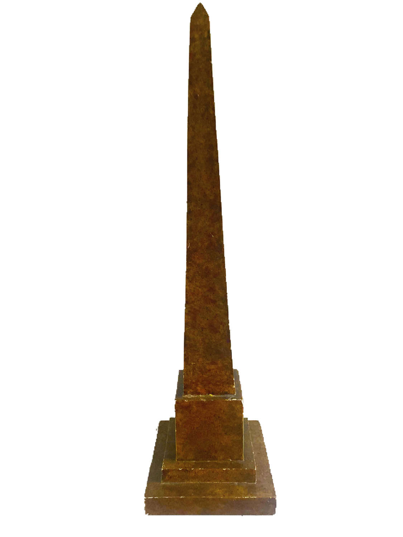 A carved wooden model of a four sided obelisk