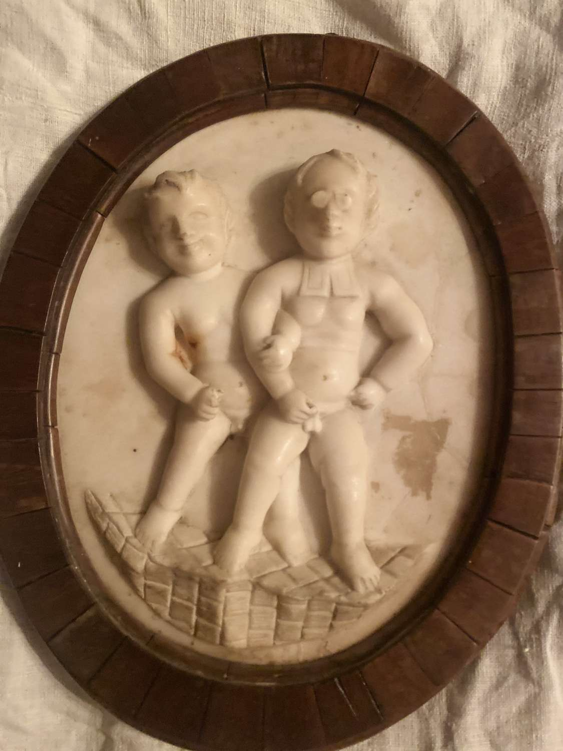 An 18th Century marble plaque of two boys walking the church