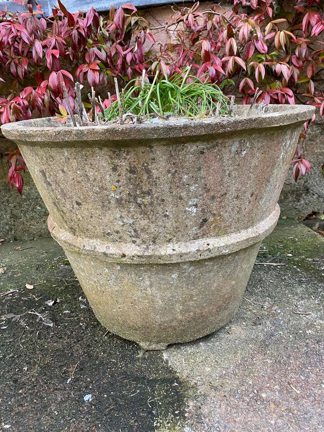 A pair of art deco reconstituted garden planters