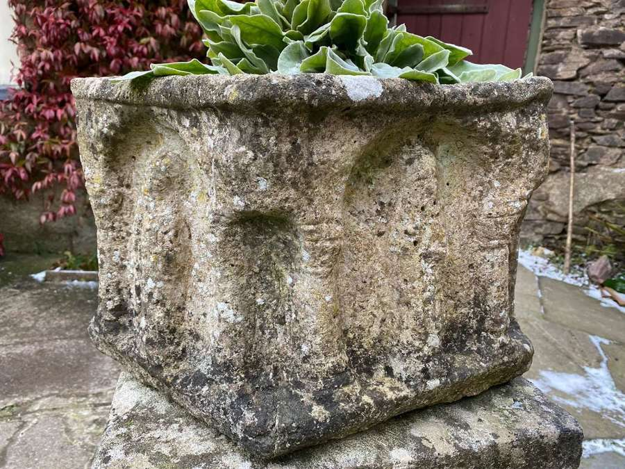 Antique style font with carved bishops